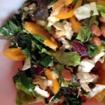 kale salad with chicken and orange tomatoes